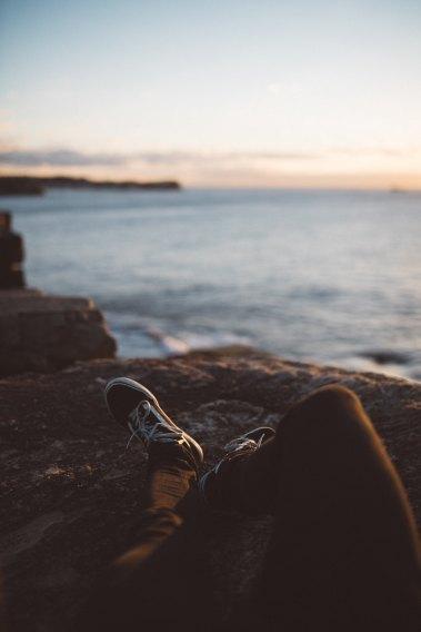 Feet overlooking water